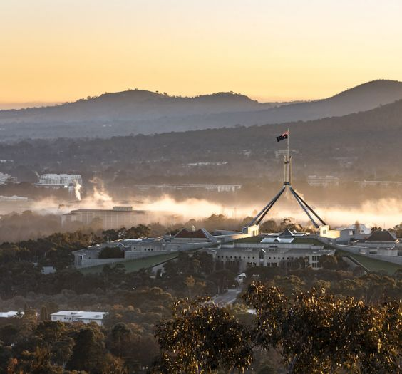 Foggy Winter Morning,Aerial view of the Parliament House Canberra,taken at Red Hill Lookout, Canberra,Australia.